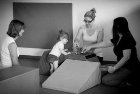 Child with therapists learning through games